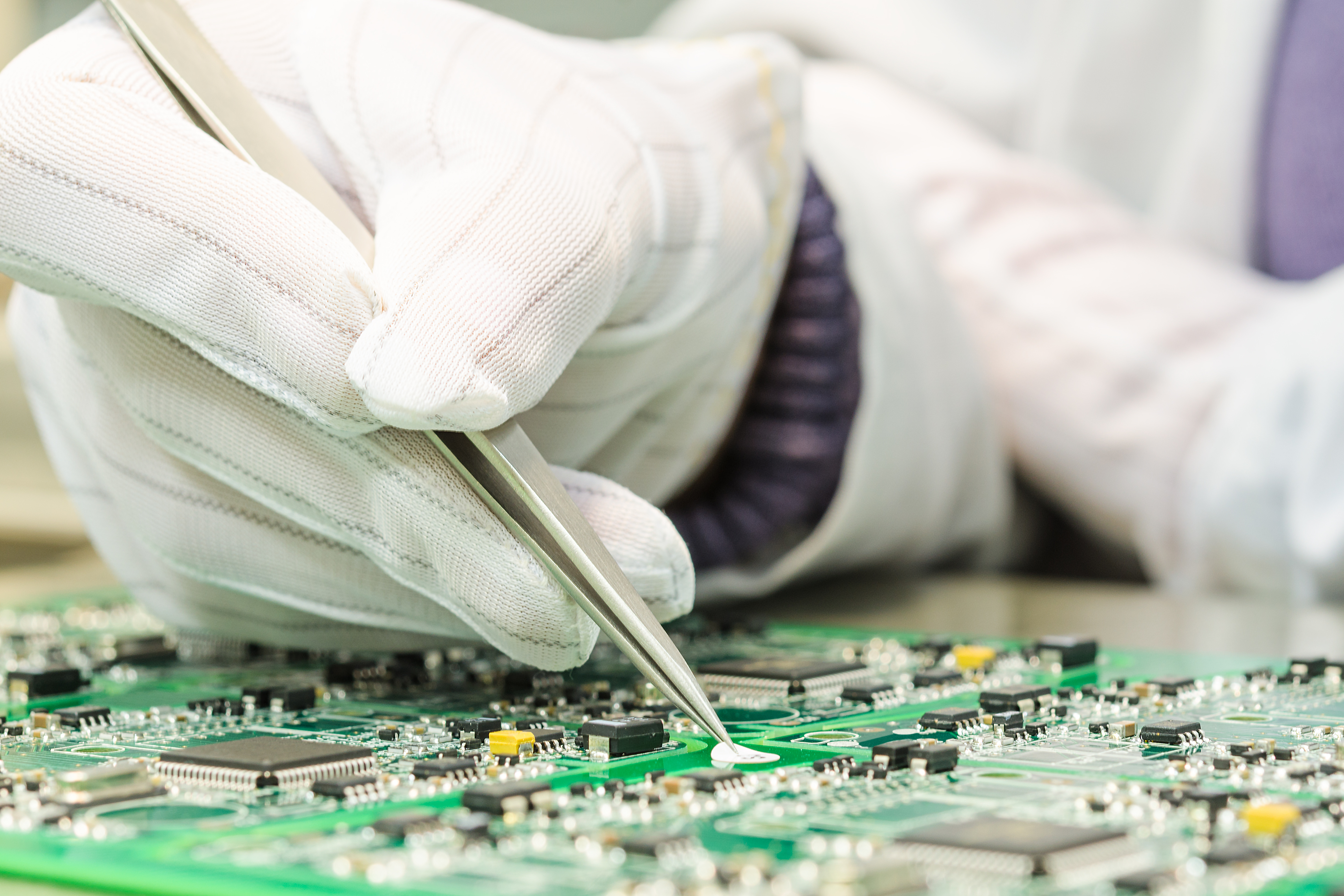 Engineering and electronic component quality control in QC lab on computer PCB turnkey manufacturing